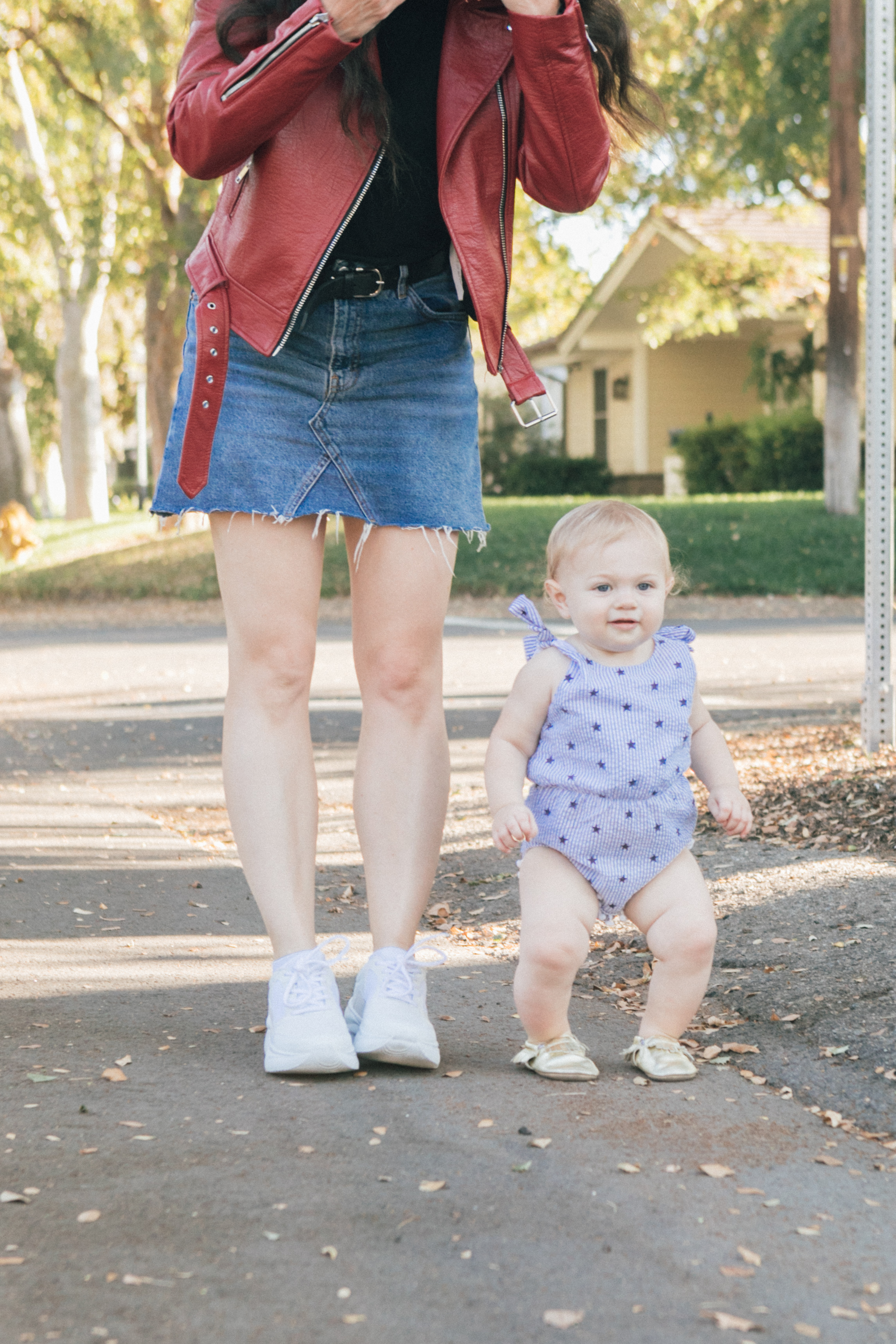 Los Angeles Blogger, RELish By Arielle pairs a red moto jacket with dad sneakers