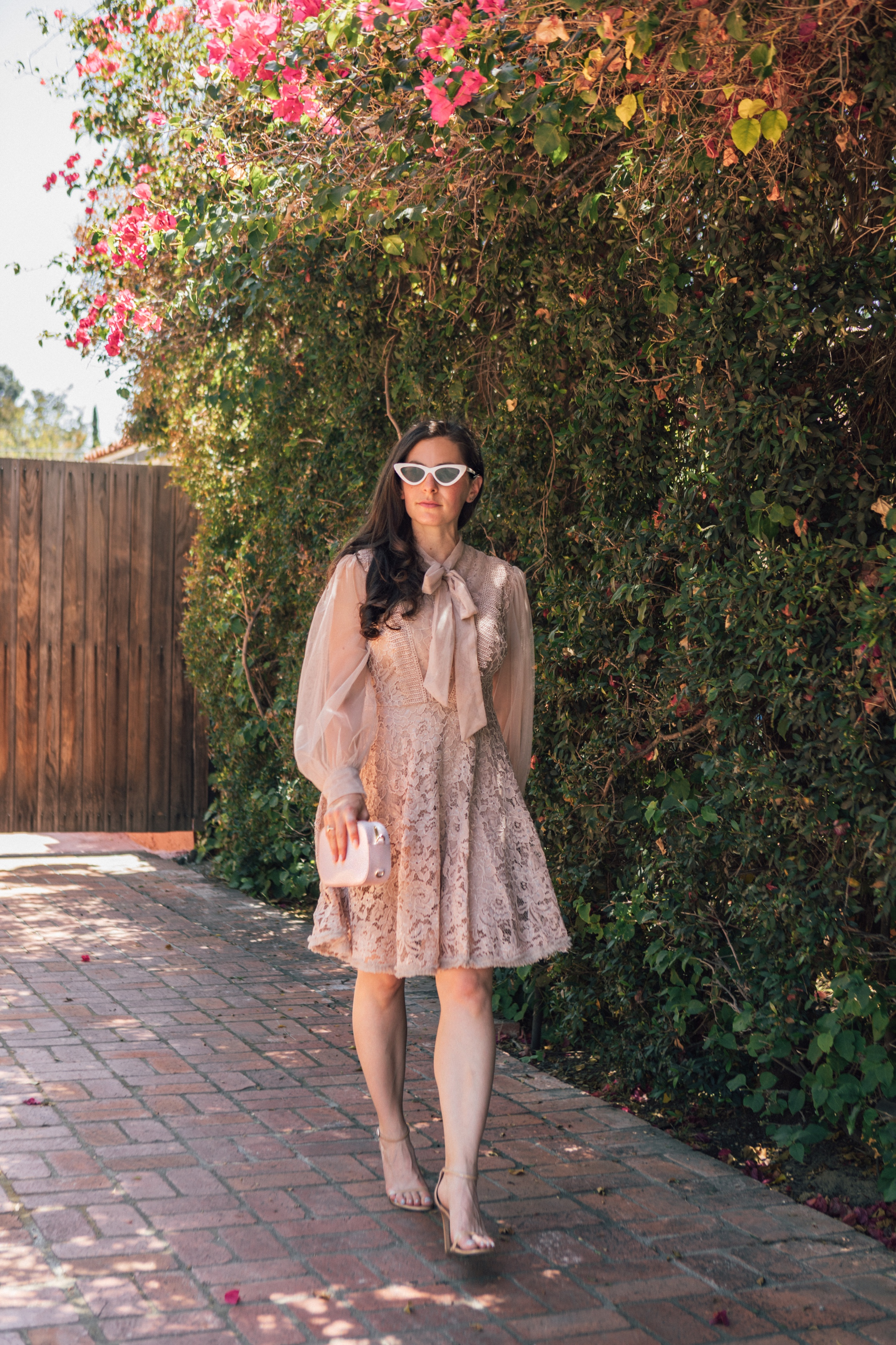 LA Blogger, RELish By Arielle wears a Chicwish lace and mesh dress with a bow