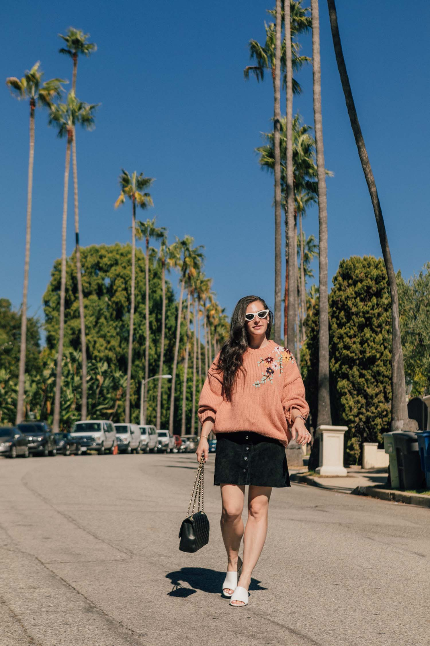 Los Angeles blogger, RELish By Arielle, wears a chunky brown sweater