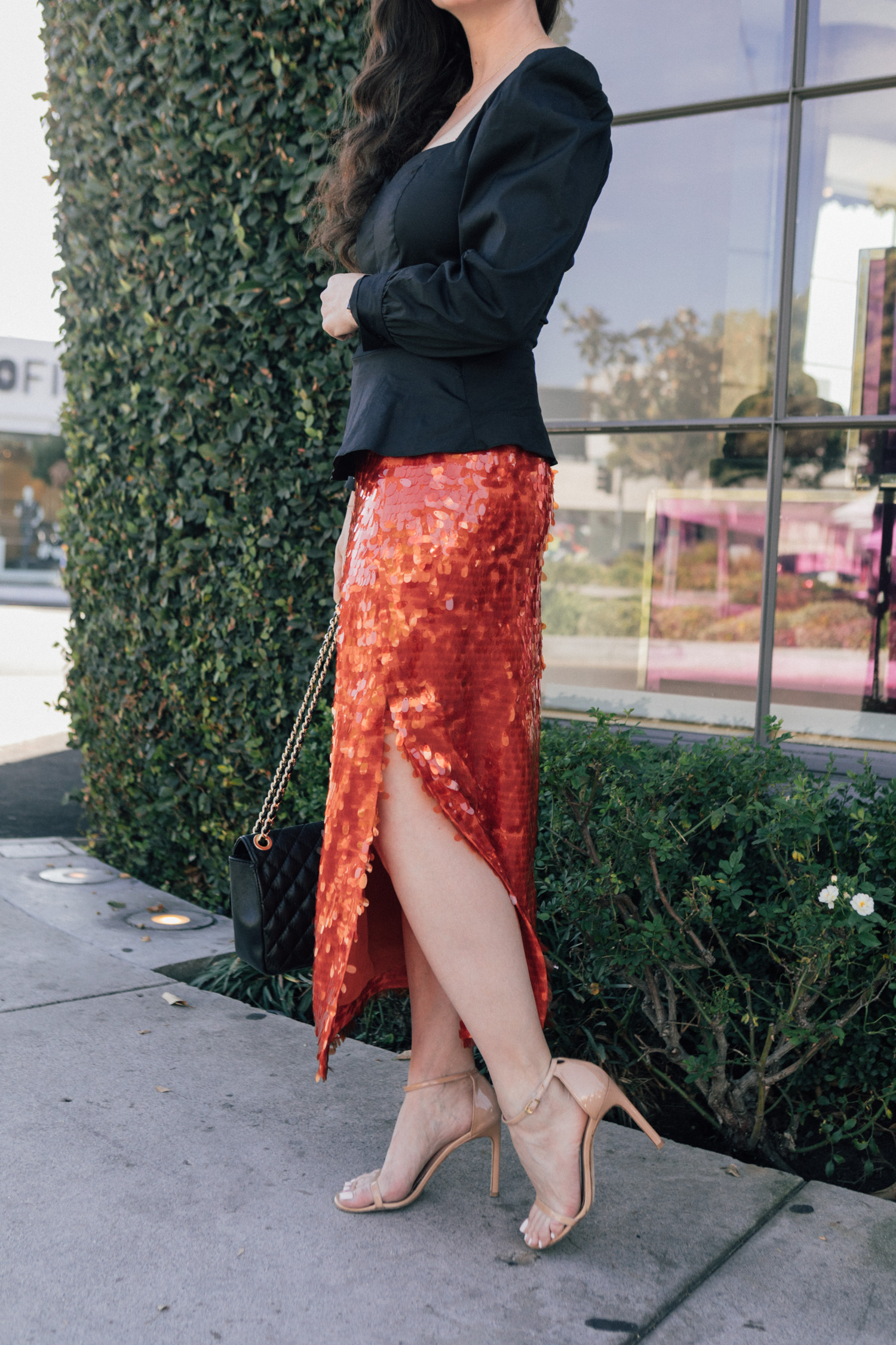 Los Angeles blogger, RELish, wears a red sequin skirt from Zara
