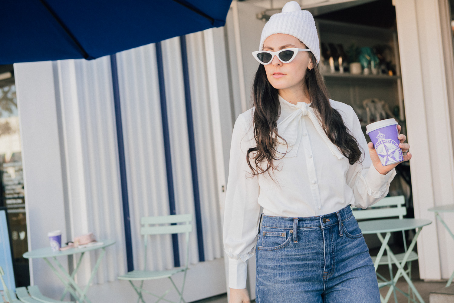 LA blogger, RELish By Arielle, wears a Chicwish white top with a bow