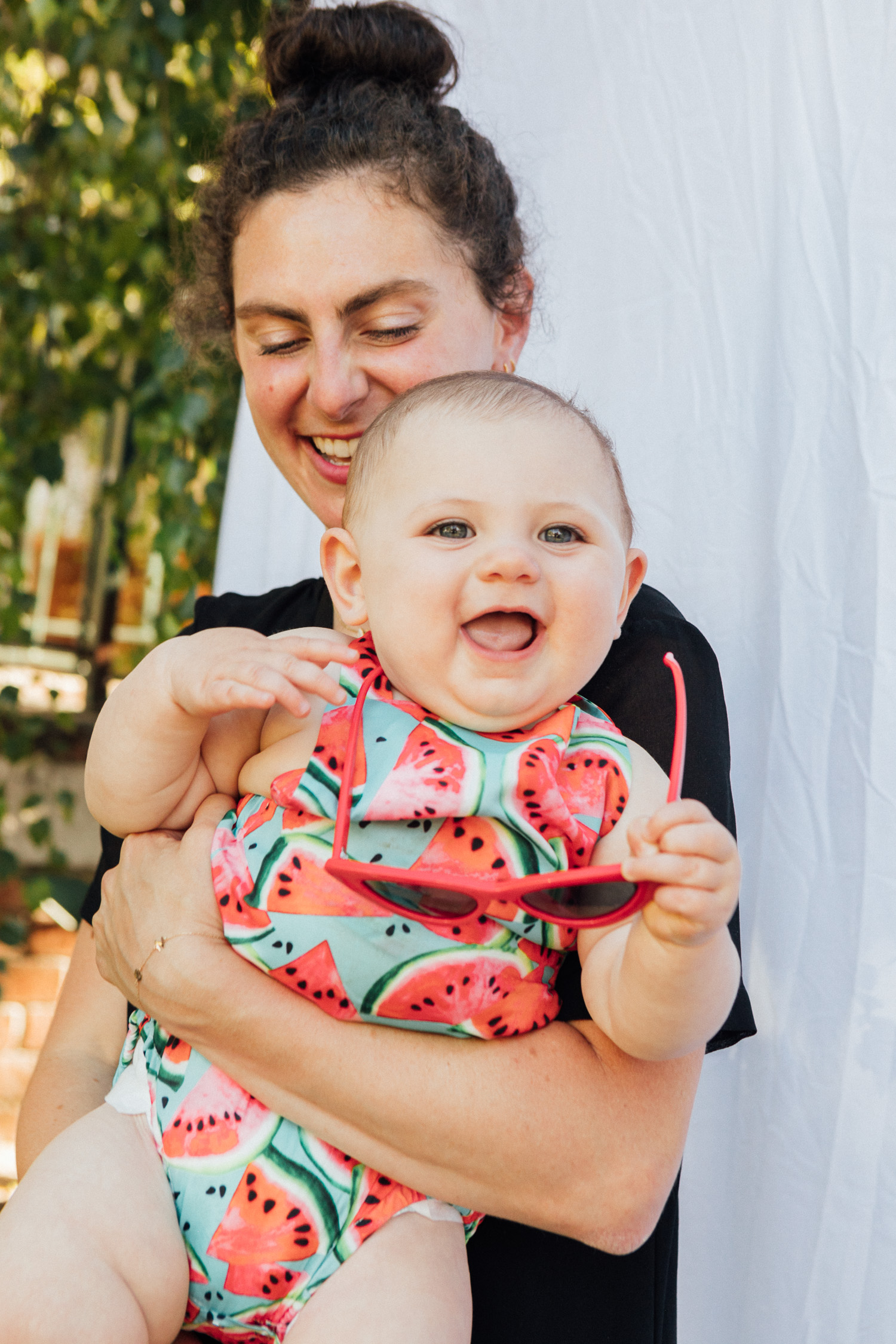 Los Angeles blogger, RELish By Arielle, shares photos with her daughter who's wearing a watermelon onesie