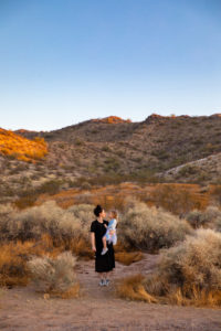 Los Angeles style and mom blogger, RELish By Arielle wears a sleeveless black dress in the Arizona desert